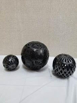 black clay openwork spheres