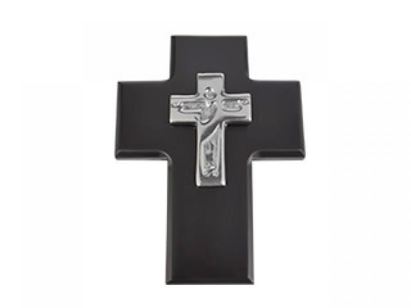 small cristo cross on chocolate wood