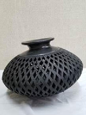 openwork vase in black clay