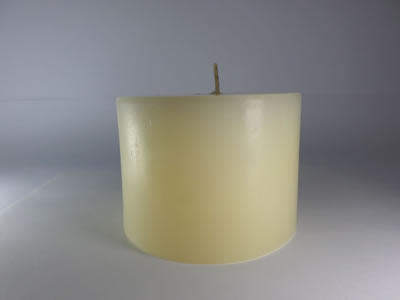 scented round beige candle