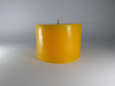 scented round yellow candle